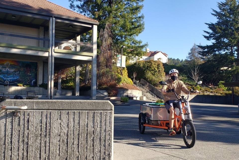 Compost Operator riding Radburro E-Trike on HSU Quad