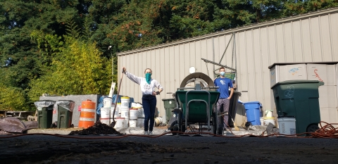 Compost Director Krissi Fiebig and Compost Operator Jerry Swider, harvesting finished compost from the Earth Tub
